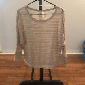 Beige, sheer lightweight top